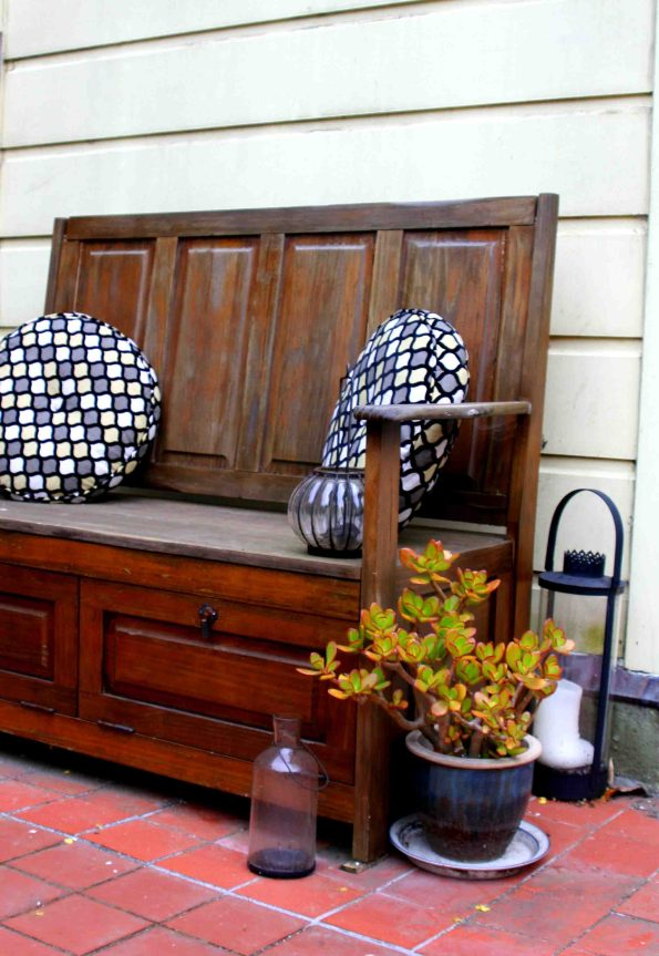outdoor bench with pillows from Bassett Furniture