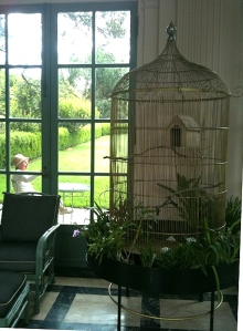 An enormous birdcage with doves and the cutest lady I've ever seen!
